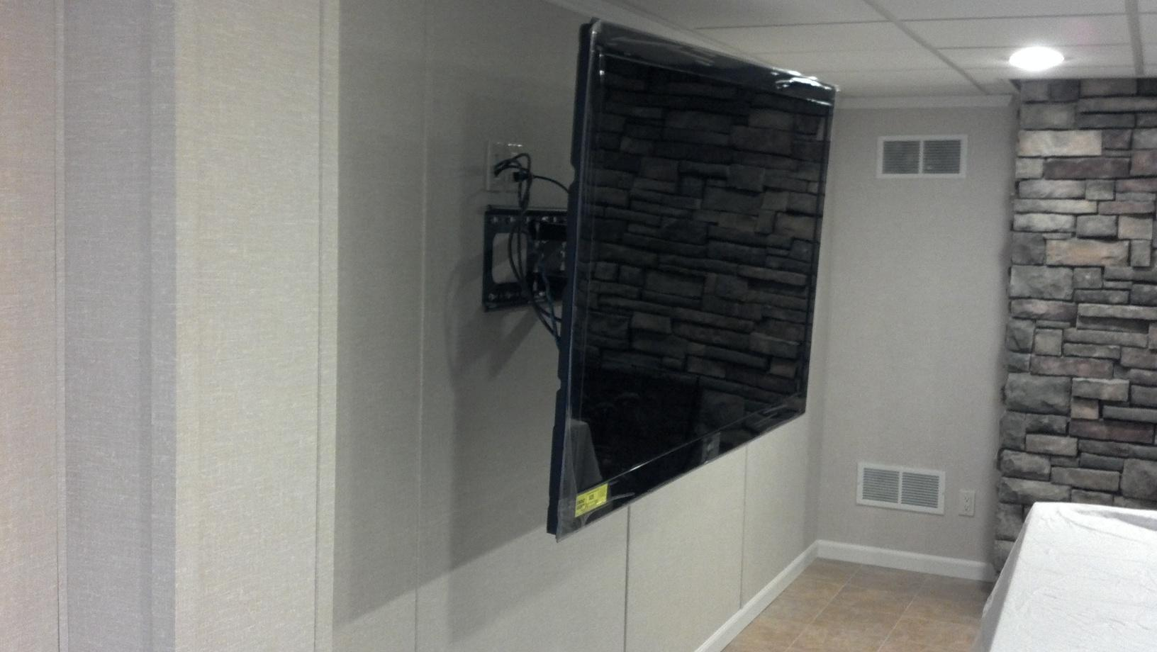 Flatscreen Mounted on Total Basement Finishing panels