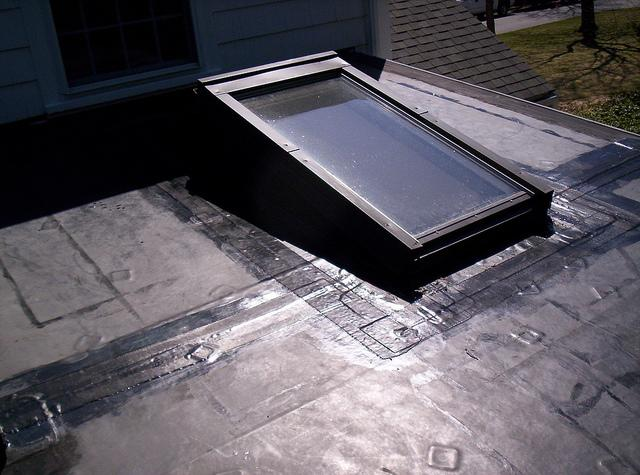 Flat Rubber Roof with Skylight