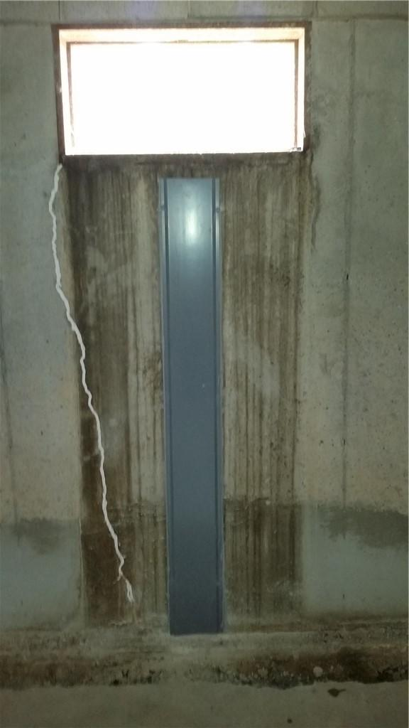 WellDuct Directs Wall Leak to WaterGuard