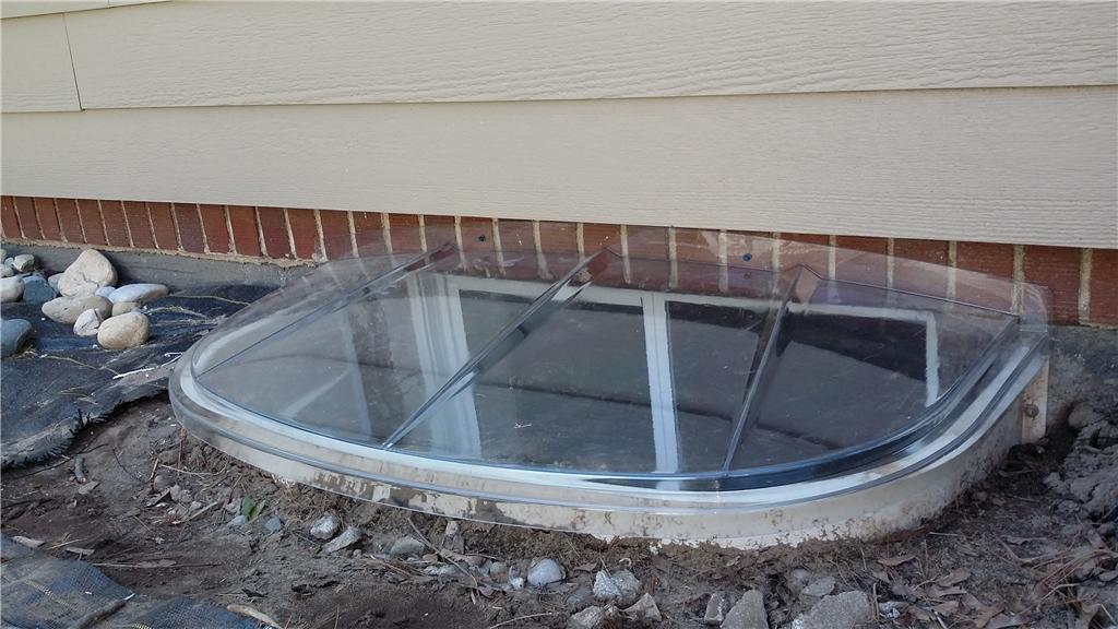 Egress Window Lid Protects Window Well