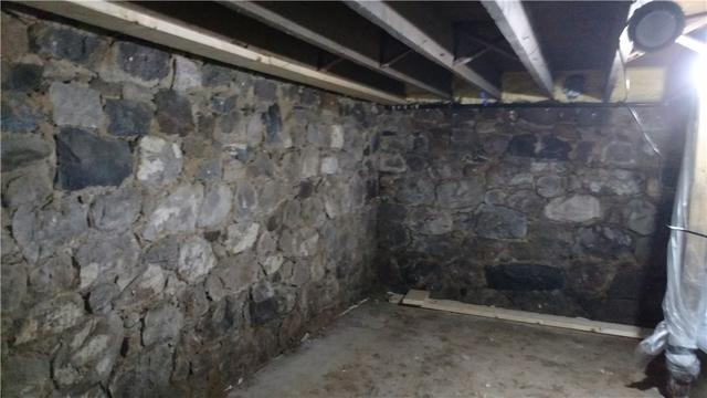 Shotcrete Revitalizes Crumbling Stone, How To Repair A Stone Basement Wall