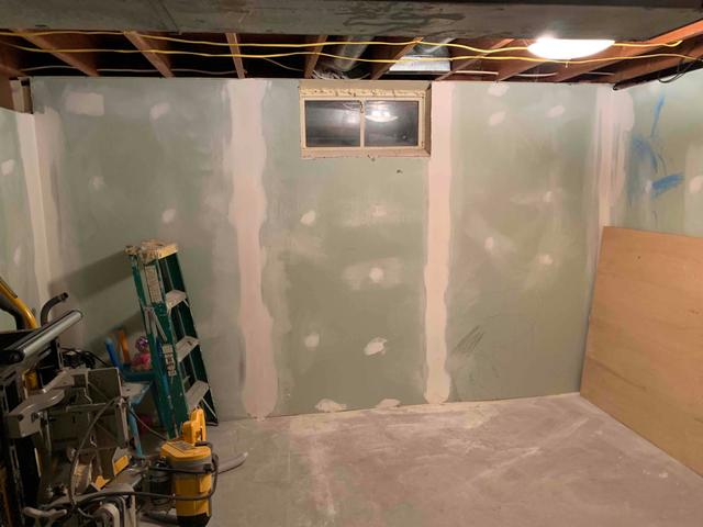 Room with small basement window that is going to be replaced with egress window for safety