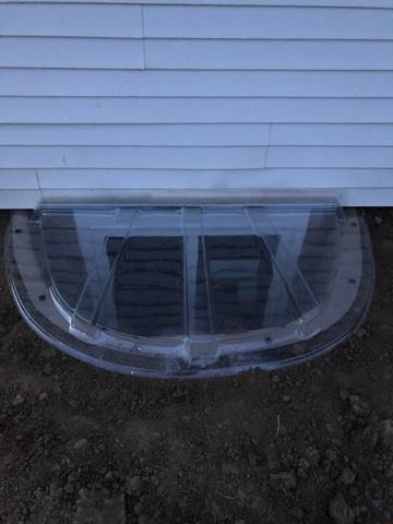 After egress window install with egress window well cover