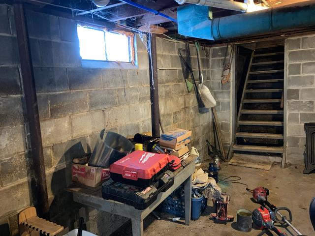The basement had water intrusion and existing beams were failing