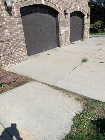 The driveway and front entry had 2-3 inches of settlement.