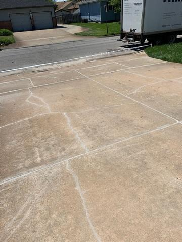 This is the driveway after PolyLevel foam was injected to even out the surface, and NexusPro was used to seal all cracks and control joints.