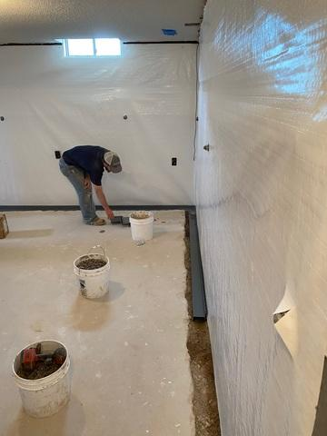 This is the final steps before the WaterGuard is finished by smoothing it over with concrete. The CleanSpace barrier was then completed and appleid to the full height of the walls.