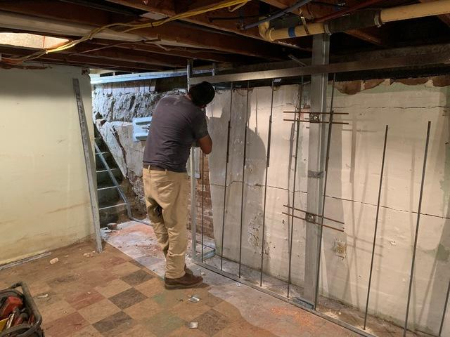 The restoration process began by installing GeoLock wall anchors and PowerBrace wall supports to stabilize the foundation, and begin returning it to its original position.
