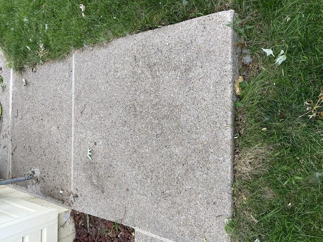 The sidewalk was also brought up back to the original level.
