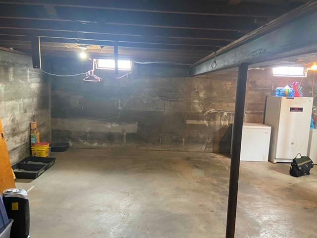 The basement was a large area and needed waterproofing installed so then it could be used.