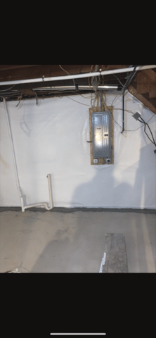 The Thrasher team installed CleanSpace in this basement in Battle Creek, NE. They custom fit the CleanSpace to the homeowner's foundation wall around the existing electrical panel and other pipes.