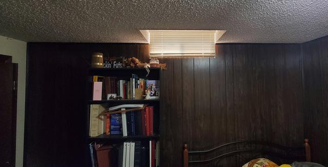 The original basement daylight windows let in very little light and could not be exited in the event of an emergency.