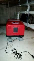 The dehumidifier has been installed in the basement.