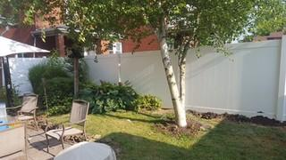 In this picture you can see the completed fence installed. It looks great with their current landscaping.