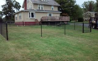 Here you can see the black chain link fence fully installed.
