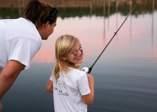 When the sun went down, the fish started biting!  The kids caught about 20 fish that evening.