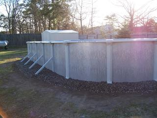 A photo of the landscaping around an above-ground pool in Freehold, NJ.