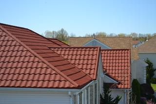 This Metal Tile Roof by DECRA is the envy of the neighborhood. Metal Tile Roofing gives you the old world look of tile without the heavy price tag or heavy concrete tiles. Metal roofing is not only designed to last a lifetime but it is light and will not put added stress on your home!