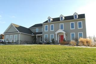 James Hardie siding with stone foundation installation in Flemington, NJ. JamesHardie Siding is a great option to keep a large home protected and looking great!