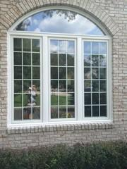 This new Villanova living room window is elegant and updated with the French style brackets.