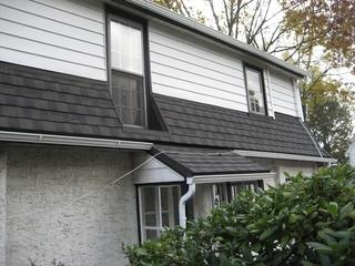 Metal shingle roofing looks identical to asphalt shingles but is more durable!