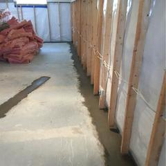 A view inside the basement of the WaterGuard® and CleanSpace® drainage systems completed. Note the WaterGuard® has been cemented in place.