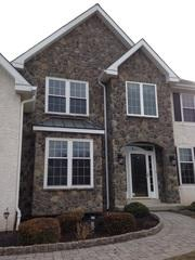 This front entry way was upgraded using manufactured stone siding by Provia and installed by the experts at Global Home Improvement