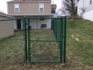 Chain-link fence surrounding our customer's back yard