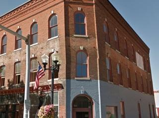 This historic building boast several upgraded apartments as well as 2 large store fronts.