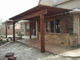 Outdoor kitchen with cedar shade arbor.