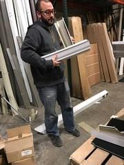Tom, our project manager, prepares materials to train our installers and estimators on the finer points of gutter installation.