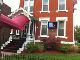 Installation of all weather outdoor SunBrite TV in front of Funeral home to offer digital signage to patrons and families as they arrive.