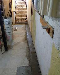 In the basement of the home where the new WaterGuard® drainage system has been installed and cemented in place.