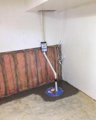 A view of the SuperSump® sump pump system installed along with the WaterGuard® drainage system.
