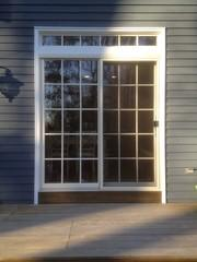 Marvin is known for quality windows but they are also the leader in replacement french and sliding patio doors. This installation features an all fiberglass frame, lifetime warranty and a top transom with matching colonial grids.
