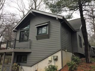 At Global Home Improvement we specialize in custom color seamless gutters which matched perfectly with the James Hardie Age Pewter Siding.