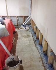 The homeowners basement during the installation of the WaterGuard drainage system and TripleSafe™ sump pump system.