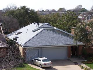 This picture shows the entire home and how the new roof adds a great deal of curb appeal!