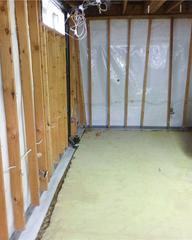 A view in a portion of the homes basement during the installation of the WaterGuard® and CleanSpace® wall systems.