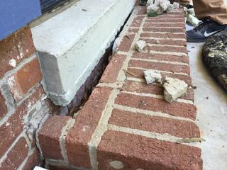 This is the front steps of the sunken porch, you can see how over time the pressure has caused the steps to break away from the house and become a hazard and an eye sore.
