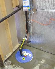 A view of the new SuperSump® sump pump system installed and cemented in place.