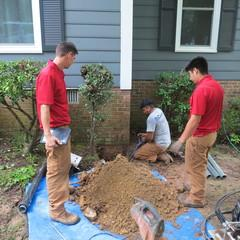 When installing Push Piers, if shrubs are in the way they may have to be cut down. Lucky this time they didn't .