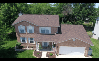 This Owens Corning Duration Brownwood roof looks amazing on this St. Charles MO home. Hail had damaged the old roof beyond repairing.