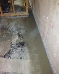 A view in the basement of the WaterGuard® installed and cemented in place.