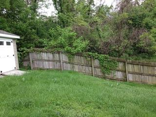 One of our customer's old fences: we replaced this wooden fence with a new vinyl privacy fence!