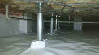 Five of the SmartJacks we installed to fix this home's sagging floors.