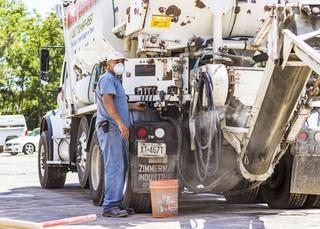 Carlos, the Concrete Specialist,  operates the concrete truck and starts to make fresh concrete.