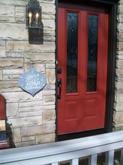 Our client was happy with the exterior color, with the exception that because the door was old the color wasn't as bold as it once was. So they wanted to keep the color, but also make it more modern and inviting. They chose beautiful hardware and the glass is goregous. The door turned out beautiful and met all of our clients wishes!