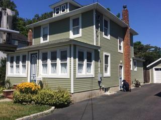 The front of the house looks great with the new Vinyl Siding.