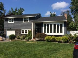 We installed 'Portsmouth Shake & Shingle' Siding, Eldorado Stone and Slocomb windows. The result came out great. The homeowner loves the new look.